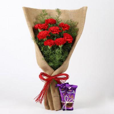 8 Red Carnations & Dairy Milk Silk Combo